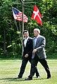 President George W. Bush walks with Prime Minister Anders Fogh Rasmussen of Denmark.jpg
