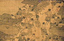 A small section of a larger scroll detailing a number of small shops lined up against the edge of a river. Several conversations can be seen taking place, however most of the people in the picture are simply filing past the shops.