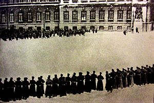Vera Karelina - The workers' procession meets the Imperial Guard on Bloody Sunday. Photograph by Karl Bulla, 1905.