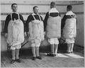 Recruits with their mattresses tied to them to serve as life preservers. Photo taken at Newport Naval Training... - NARA - 533695.tif