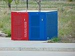 Red & blue bicycle lockers at 5600 W Old Bingham Hwy station, Apr 16.jpg
