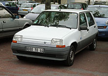A white Renault car in a car park