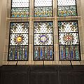 Restored stained glass windows in City College's Great Hall.JPG