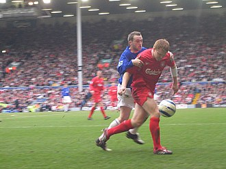 John Arne Riise - Riise competing in a match against Everton.