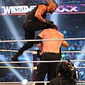 Rollins springboard knee at WM30.jpg
