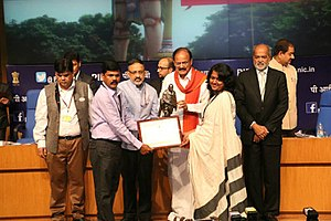 Rourkela - Rourkela Municipal Commissioner and Rourkela ADM taking award from Shri M.Venkaiah Naidu