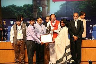Rourkela - Rourkela Municipal Commissioner and Rourkela ADM taking award from Shri M.Venkaiah Naidu
