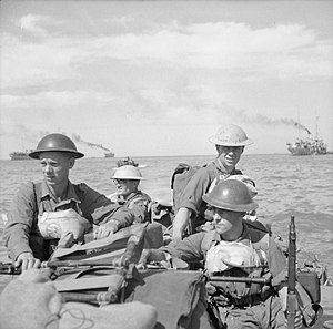 British troops in a landing craft make their way ashore on Ramree Island, 21 January 1945.