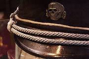 The black cap with a Totenkopf of the SS