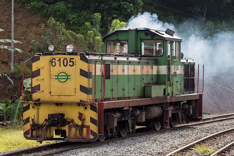 Yellow and green diesel train engine.