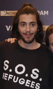 Sobral Wearing The S O S Refugees Shirt