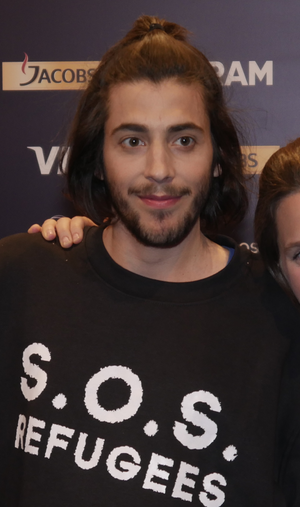 "Salvador Sobral - Sobral wearing the ""S.O.S. Refugees"" shirt."