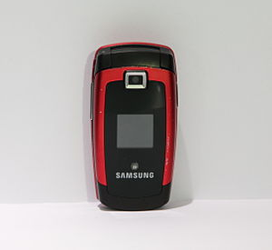 English: A red Samsung Mobile Phone Svenska: E...