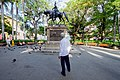 Secretary Kerry Looks at a Statue in the Plaza de Bolivar (29843164232).jpg