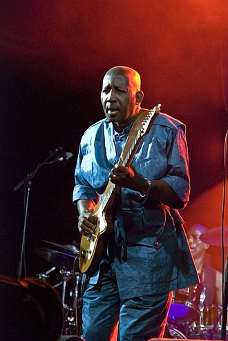 Sekouba Bambino - Sekou Bembeya Diabaté performing as guitarist of Bembeya Jazz from Guinea Conakry
