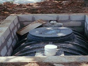 Septic tank - The same tank partially installed in the ground