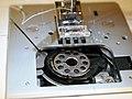 Sewing machine bobbin under plate.jpg