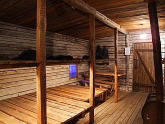 Museum of the Occupation of Latvia - Reconstruction of shack from Gulag in museum. The picture does not say, how many people were crammed into such a shack...