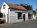Shops on High Street (B1145) - geograph.org.uk - 969818.jpg
