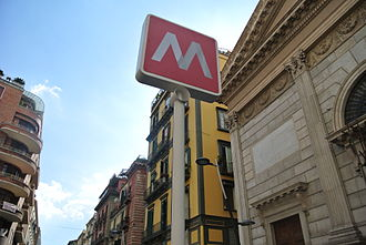Art Stations of the Naples Metro - Signs in the Art Stations are simple and clear. In the photo, the Toledo Metro stop, with the Church of San Nicola alla Carità on the right.