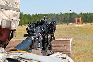M320 Grenade Launcher Module - A U.S. Army soldier training with an M320 mounted on an M4 carbine