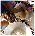Soungouf - millet flour 5. sifted adding water.jpg