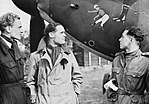 Squadron Leader Douglas Bader (centre) and fellow pilots of No. 242 Squadron, Flight Lieutenant Eric Ball and Pilot Officer Willie McKnight, admire the nose art on Bader's Hawker Hurricane at Duxford, October 1940. CH1412.jpg