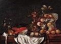 Still life of fruit in a porcelain bowl, a golden goblet, lobster and a rummer, by monogrammist JHV.jpg