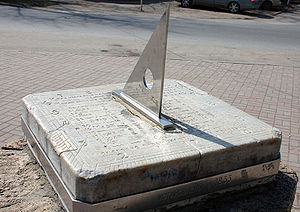 The gnomon is the triangular blade in this sundial