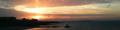 Sunrise over Salthill, Galway from Blackrock Pier.png