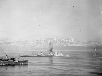 HMS Vindictive (1918) - Vindictive nearly hit by bombs while at anchor in Harstad fjord, 17 May 1940.
