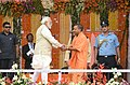 The Prime Minister, Shri Narendra Modi at the swearing-in ceremony of the new government of Uttar Pradesh, at Lucknow on March 19, 2017. The Chief Minister of Uttar Pradesh, Yogi Adityanath is also seen.jpg