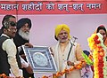 The Prime Minister, Shri Narendra Modi being presented a memento by the Chief Minister of Punjab, Shri Parkash Singh Badal, at National Martyrs Memorial, in Hussainiwala, Firozpur, Punjab on March 23, 2015.jpg