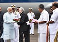 The Prime Minister, Shri Narendra Modi being received by the Governor of Kerala, Justice (Retd.) Shri P. Sathasivam and the Chief Minister of Kerala, Shri Pinarayi Vijayan on his arrival, at Kochi, in Kerala on June 17, 2017.jpg