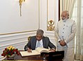 The Prime Minister of the Democratic Socialist Republic of Sri Lanka, Mr. Ranil Wickremesinghe signing the visitors' book, at Hyderabad House, in New Delhi (1).jpg