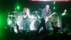 """The Who performing in 2007(on left: Roger Daltrey, on right: Pete Townshend), with Zak Starkey (drums) and John """"Rabbit"""" Bundrick (keyboards)"""