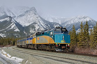 EMD F40PH - Rebuilt Via F40PH-2D No. 6434 leading the Canadian near Jasper, Alberta in 2011, with an original unit following