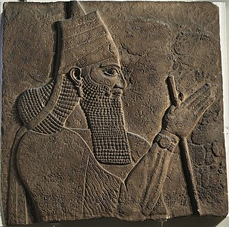 Nochiya tribe - Assyrian king, Tiglath-Pileser III, wearing a Shashta similar to the ones traditionally worn by the Nochiyaye.