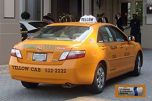 English: Rear view of a Yellow Cab Hybrid Taxi...