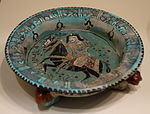 Tripod dish with horsemen, Mina'i ware,Central Iran, Seljuk period, late 12th or early 13th century AD, earthenware with polychrome enamels and gold over turquoise glaze and colors - Cincinnati Art Museum - DSC04008.JPG