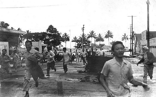 People run from an approaching tsunami in Hilo, Hawai'i, on 1 April 1946; note the wave just left of the man's head in right center of image.