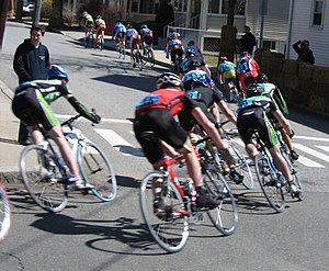 Criterium - Collegiate cyclists take a tight downhill corner in the Boston Beanpot Criterium at Tufts University