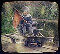 Turbanned man on railway hand car holding red flag LCCN2004707693.jpg