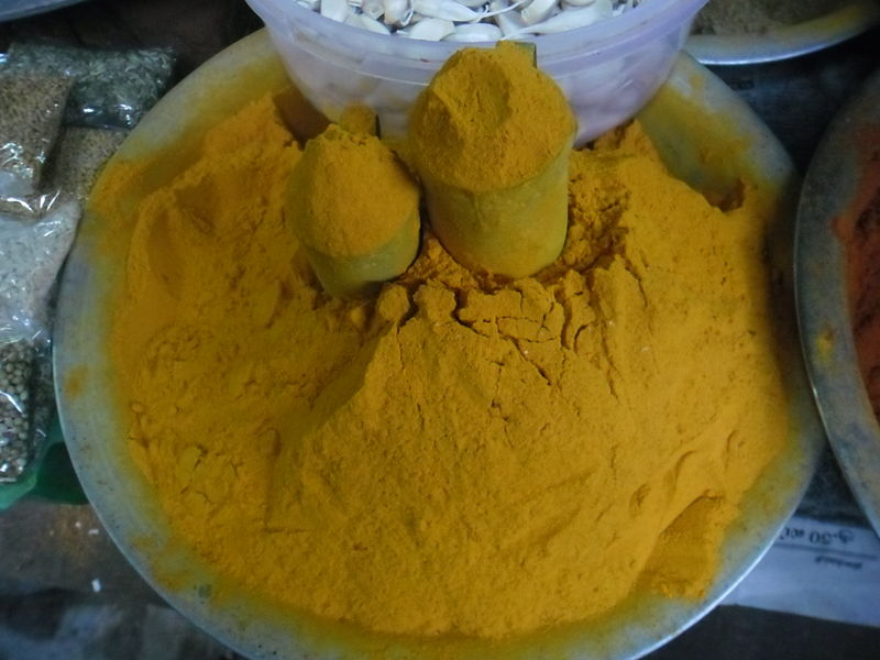 File:Turmeric powder in stall.JPG
