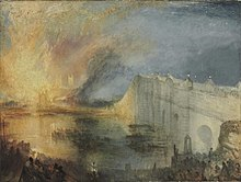 On the right, a white stone bridge arches over a wide river. On the far side and to the left, a gabled building is outlined in front of huge flames rising up to the night sky; they are reflected in the water and illuminate part of the bridge and a building with two towers in the background. There are several boats full of people in the river, and large crowds are assembled on the near bank and on the bridge.