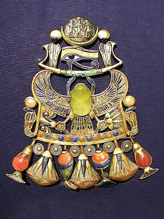 Libyan desert glass - Tutankhamun's pectoral features a scarab carved from desert glass.