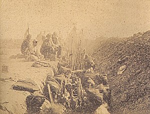 Battle of Tuyutí - Trench with Uruguayan soldiers from the 24 April Battalion at Tuyutí, taken a month after the battle. Albumen print, 1866.