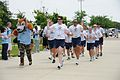 U.S. Air Force Brig. Gen. Ian Dickinson, commander, 81st Training Wing, leads the 2010 Special Olympics torch run team through a corridor of cheering Airmen en route to Welch Auditorium at Keesler Air Force 100515-F-BD983-003.jpg