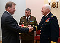 U.S. Army Maj. Gen. James Adkins, right, the adjutant general of the Maryland National Guard, gives a gift to a representative of the Estonian Defense League during Saber Strike 2013 in Raplamaa, Estonia 130605-Z-YE885-007.jpg