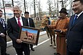 U.S. Defense Secretary Chuck Hagel holds a photograph of his horse as Mongolian Defense Minister Dashdemberal Bat-Erden looks on at the Mongolian Ministry of Defense in Ulaanbaatar, Mongolia, April 10, 2014 1404010-D-BW835-1023a.jpg